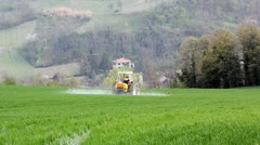 Tractor spraying herbicide in a wheat field. Stock Footage