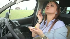 Beautiful young businesswoman makeup in traffic jam - stock footage