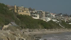 Beach Homes on Cliff Overlooking Pacific Ocean Stock Footage