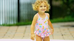 Young Caucasian Child Enjoying Water Outdoors Stock Footage