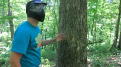 Paintballing in the woods (HD) c Stock Footage