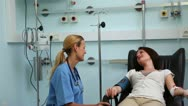 Nurse speaking with a transfused patient Stock Footage