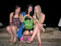 Three girls drinking booze from a bucket Stock Photos