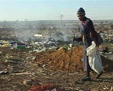 A old woman  at  dump site Stock Footage