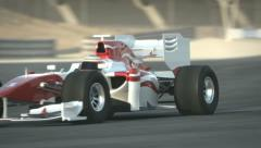 F1 race car on desert circuit Stock Footage