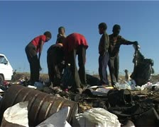 Kids at the dump site looking in garage bags Stock Footage