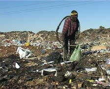 Impoverished African man at dump site  - stock footage