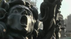 A statue of Medusa seems to be crying out in horror. - stock footage
