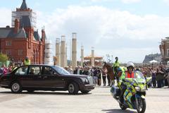Queen with Police escort Stock Photos