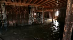 Home flood zoom in basement damage P HD 1967 - stock footage