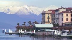 The shores of Lake Como with the town of Bellagio and the Italian Alps in Stock Footage
