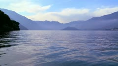 A water level view of a beautiful mountain lake. Stock Footage
