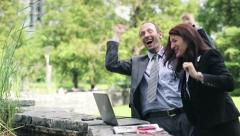 Successful business people with laptop in the park HD Stock Footage