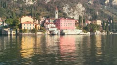 POV from a boat of the shores of Lake Como with the town of Varenna and the Stock Footage