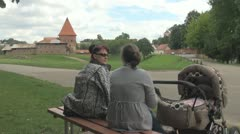 Tolking women in front of Castle Stock Footage