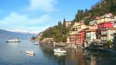 The beautiful shores of Lake Como with the town of Varenna and the Italian Alps Stock Footage