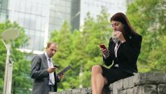 Business people during break in the city park HD Stock Footage
