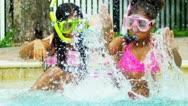 Laughing Little Girls Enjoying Swimming Pool Stock Footage
