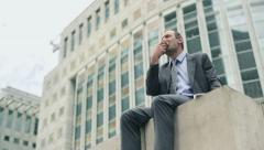 Businessman having a break for lunch in the city HD Stock Footage