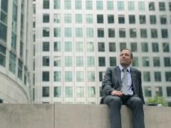 Businessman with laptop having a break and relaxing in the city NTSC Stock Footage
