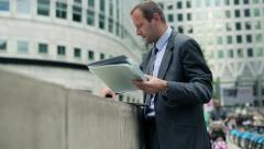 Businessman finishing working on laptop in the city HD Stock Footage