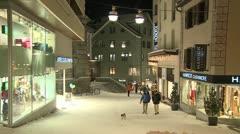 Pedestrians walking on the clean modern streets of St. Moritz, Switzerland in - stock footage