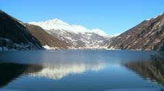 A beautiful mountain lake in the Swiss Alps. - stock footage