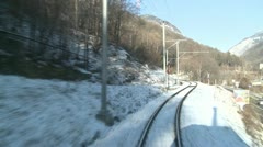 A time lapse POV shot from the front of a train moving through a mountainous Stock Footage