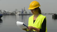 Female Docker with clipboard Stock Footage