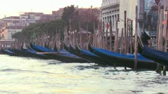 Gondolas bob in the waves along a canal in Venice, Italy. - stock footage