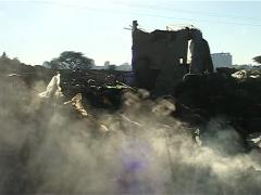 Dump site fires smoke in the morning Stock Footage