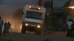 Truck and motorcycle on slum street Stock Footage