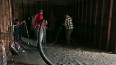 Flood basement pump mud and water out P HD 2074 Stock Footage