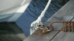 Close of rope tethering boat at mooring. Stock Footage