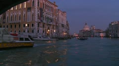 Dusk on the canals of Venice, Italy passing under the Academia Bridge. Stock Footage