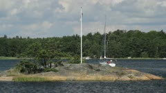 Yacht sails to port in Stockholm archipelago in Sweden. Stock Footage
