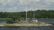 Stock Video Footage of Yacht sails to port in Stockholm archipelago in Sweden.