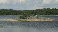 Very small Swedish island with flag Stock Footage