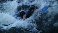 Canoeist washed away on fast water at nightfall on Stockholm channel Stock Footage