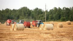 Harvester. tractor makes bales of straw. Stock Footage