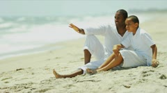 Ethnic parent enjoying holiday son time by ocean   Stock Footage