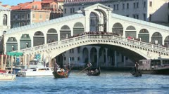 Gondolas under the Rialto Bridge in Venice, Italy. - stock footage