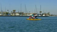 Middle-Aged Ladies Riding Water Bikes- Long Beach CA Stock Footage