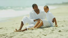 Ethnic boy chilling together loving father on beach   Stock Footage