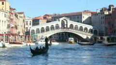 Gondolas under the Rialto Bridge in Venice, Italy. Stock Footage
