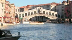 Time lapse of boats and gondolas under the Rialto Bridge in Venice, Italy. Stock Footage