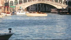 Time lapse of boats and gondolas under the Rialto Bridge in Venice, Italy. - stock footage