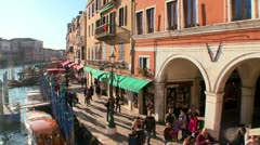 Cool timelapse shot of pedestrians walking along the canals of Venice Italy. - stock footage