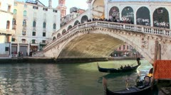 Time lapse of gondolas under the Rialto Bridge in Venice, Italy. - stock footage