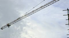 The operating arm of crane moving in a building construction site Stock Footage